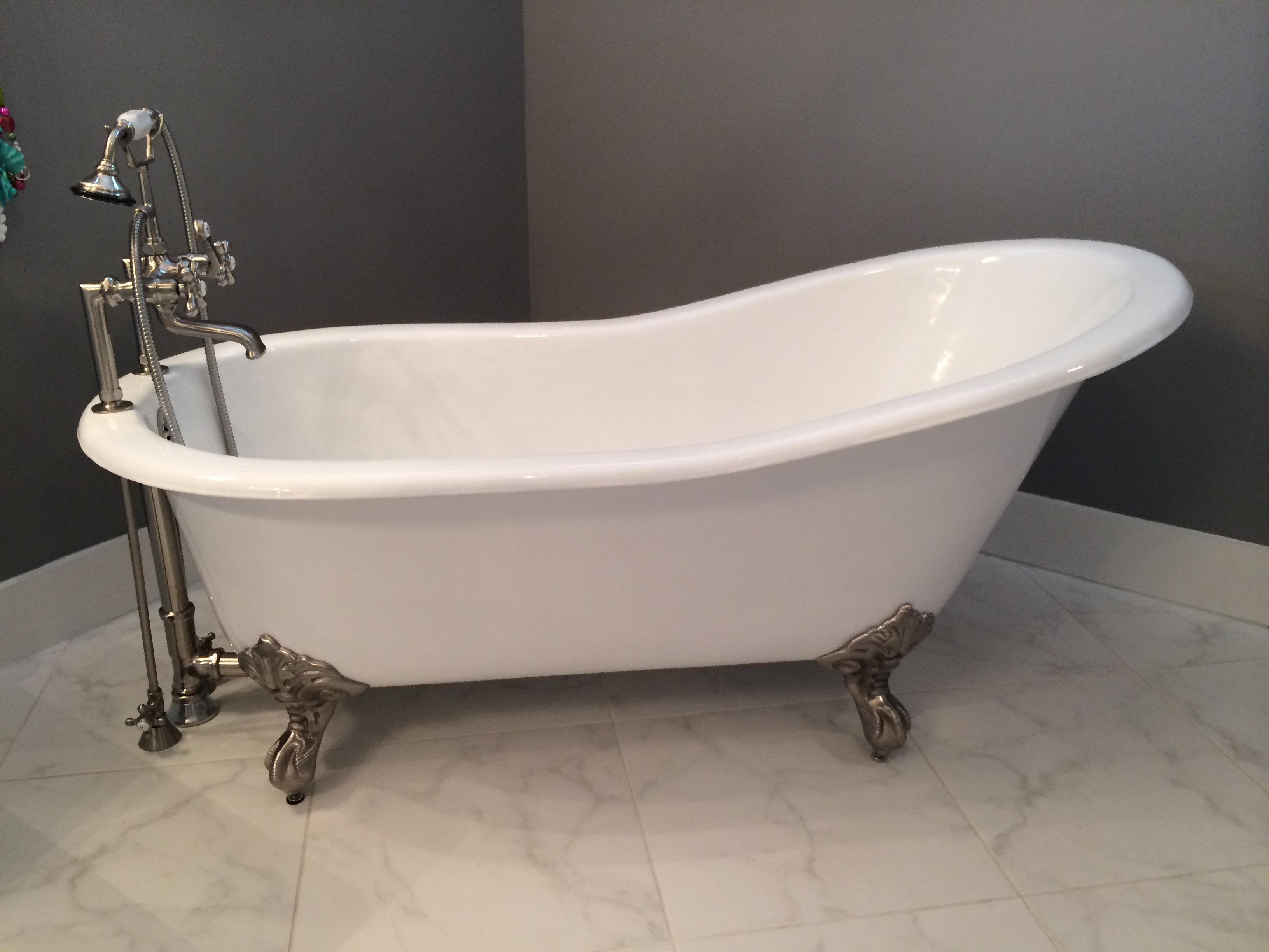 why buy a new cast iron clawfoot bathtub instead of an antique vintage tub. Black Bedroom Furniture Sets. Home Design Ideas